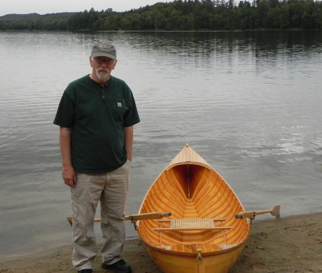 Bill Michelfelder with his Raider guideboat.