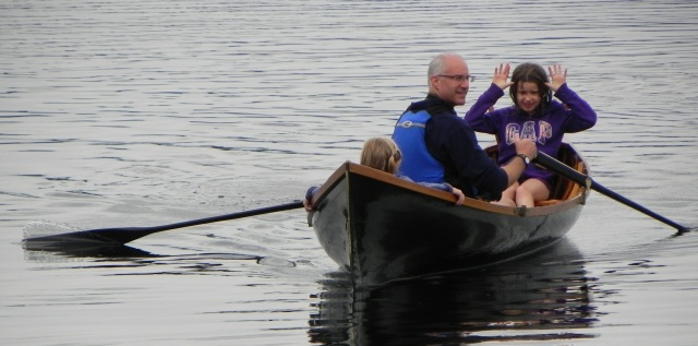 Paul out for a row with his girls.
