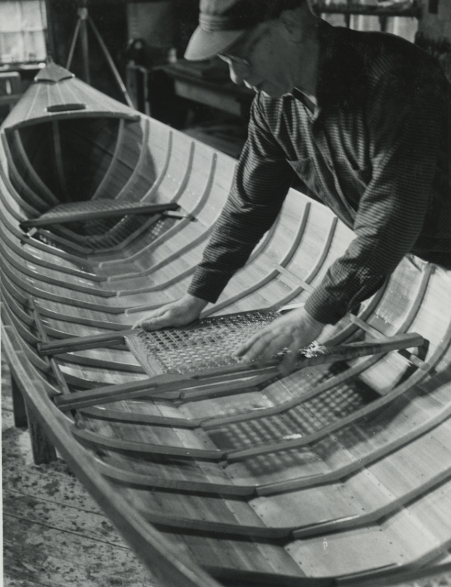 Willard with one of his newly completed guideboats.  The handhold in the deck is characteristic of his guideboat construction.  Photo courtesy of the Adirondack Museum.