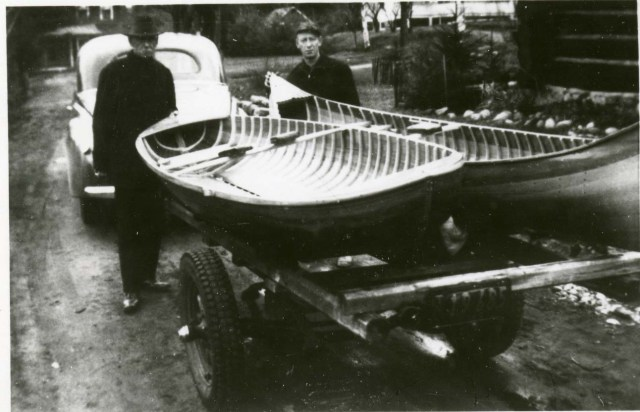 Willard and his father Theodore.  These are two custom built boats built for a client on Spit Fire Lake.