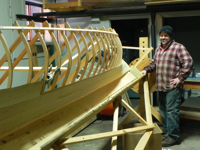 Keith Austin with his latest guideboat under construction.