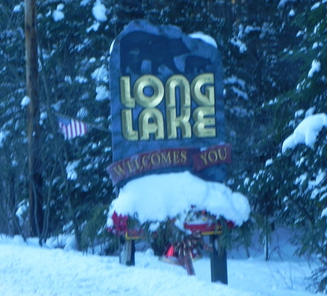 Sign announcing arrival in Long Lake