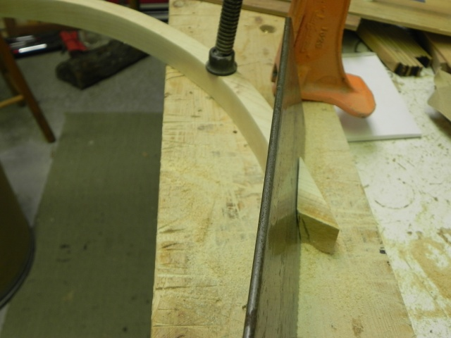 Cutting the hoop on an angle to form the bow.
