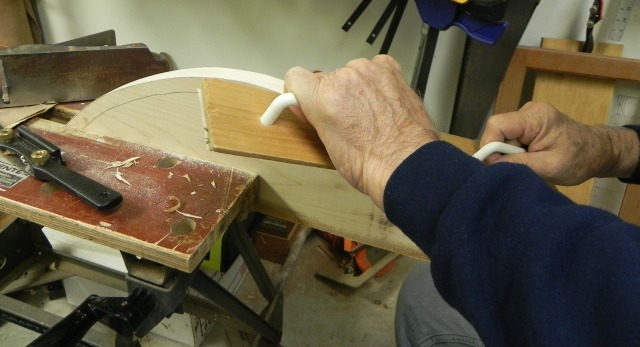 Final shaping of the bow using a long board.