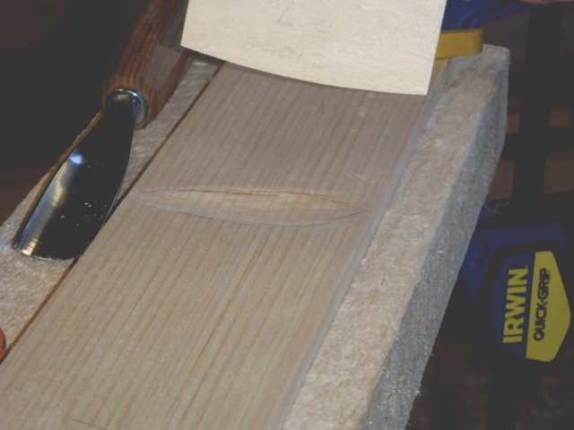 Proper plank curvature at one station.  Template and gouge used to form the curvature are shown.