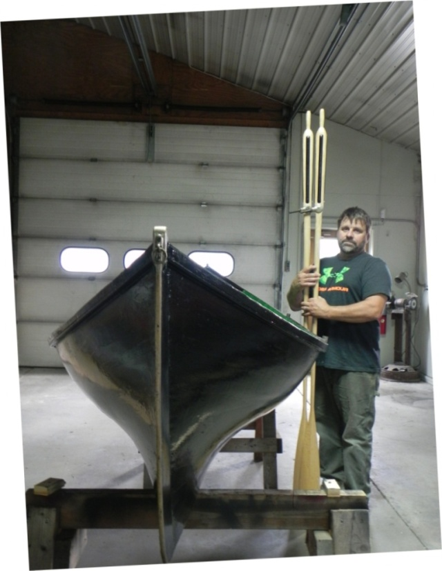 Keith Austin with Raider guideboat he is restoring.