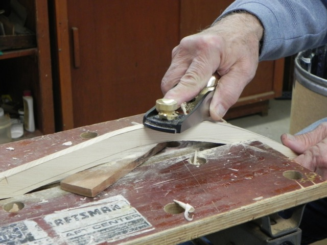 Shaping the hull side of the rib using a block plane. Shaping the hull side of a rib using a block plane.