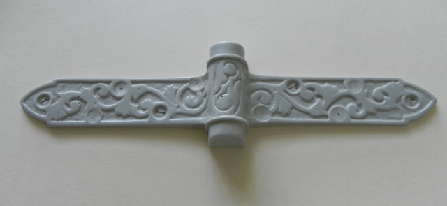 A strap pattern cast from the mold.