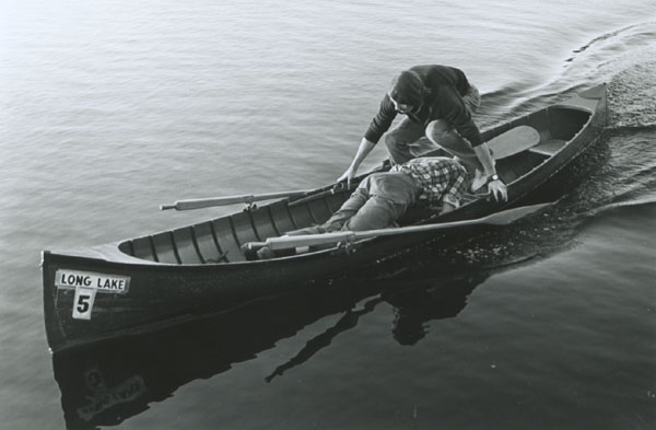 Guideboat racers switching positions during a race. Photo courtesy of The Adirondack Museum.