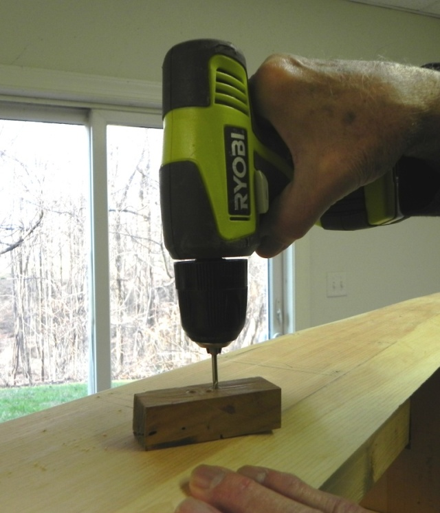 Using a squared-up hole in a cherry block to drill true holes for fastening the ribs.